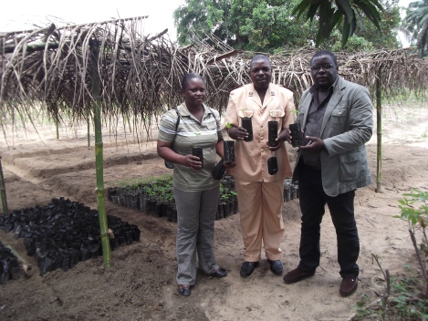 Part of the project team with some of our first seedlings.