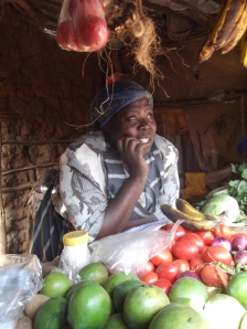 One woman in Kibera who has expanded her vegetable stand with a loan from the savings group.