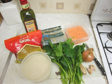 Ingredients for Monday's dinner and Tuesday's lunches: rice, lentils, spinach, onion, ginger, garlic, spices, and oil.