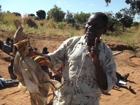 George Gunde showing off his three ears of maize.
