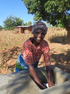 Dorothy using the new clothes washing station that keeps dirty soapy water away from the drinking source.
