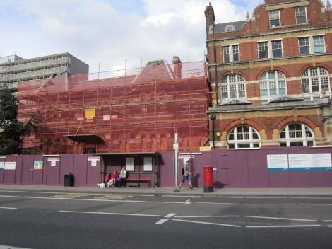I come out onto Walworth Road by the Cumin Museum, which is still covered in scaffolding after a towering inferno two months ago.