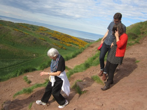 My grandma, sister and brother-in-law traipsing about on Arthur's Seat