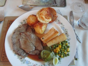 Yorkshire pudding (bread at top of plate) is a perfect pair for any Sunday roast.